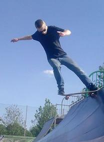 Robin Lee on a skateboard
